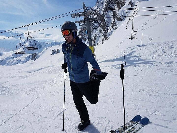 stretching while on ski slope
