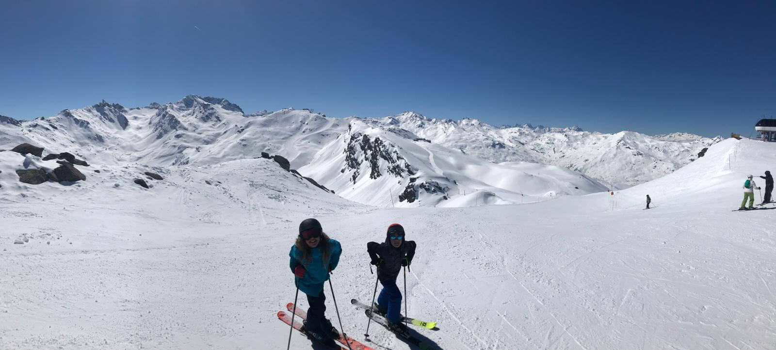 two skiers on slope after yoga stretches