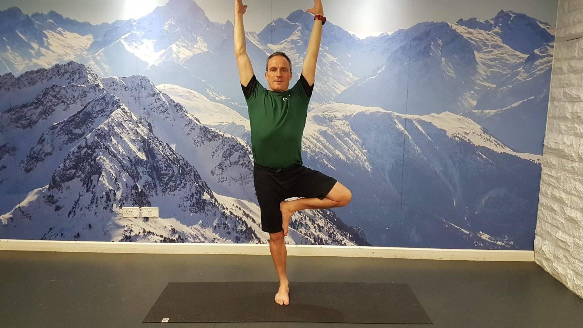 man doing beginner yoga pose